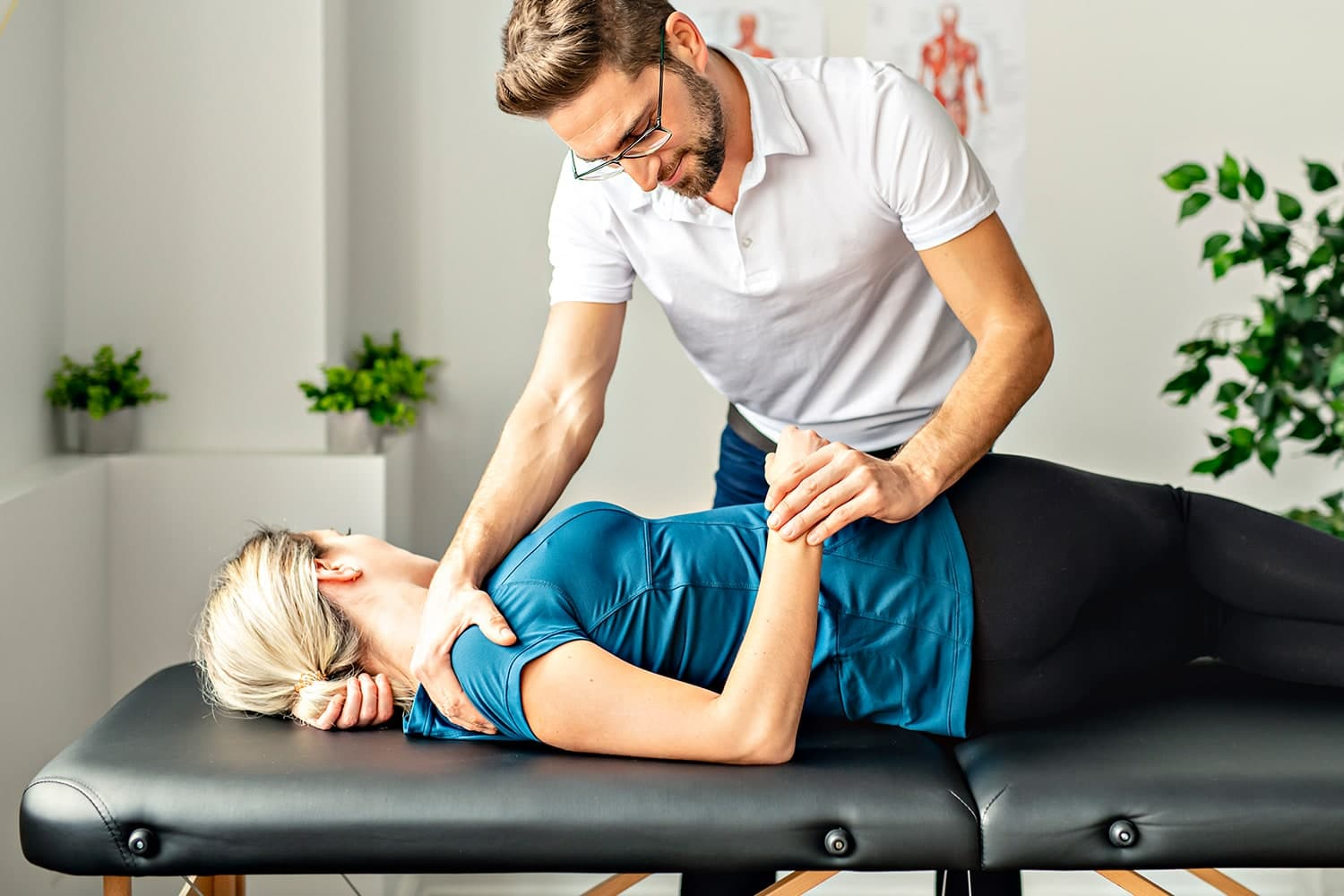 Chiropractor working on patient